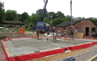 Concrete pump pouring slab