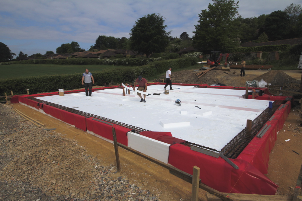 Laying second layer of insulation